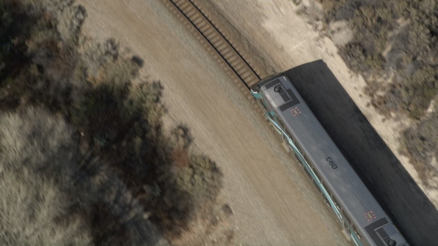 5K stock footage aerial video of tracking the front of a commuter train in Santa Clarita, California Aerial Stock Footage | AX0005_027
