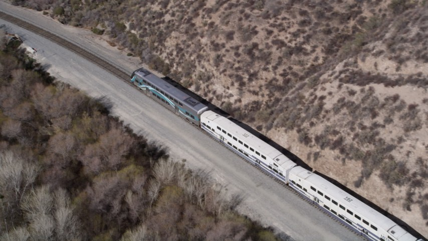 5K stock footage aerial video track Metrolink train traveling near Santa Clarita, California Aerial Stock Footage   AX0005_028