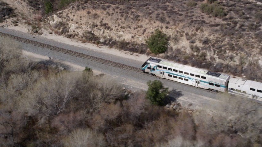 5K stock footage aerial video of tracking Metrolink train near Santa Clarita, California Aerial Stock Footage | AX0005_029