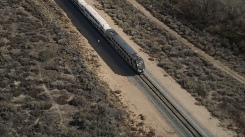 5K stock footage aerial video of a Metrolink train near Santa Clarita, California Aerial Stock Footage | AX0005_030