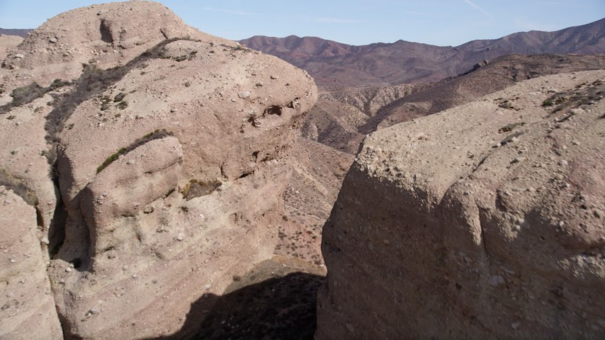 5K stock footage aerial video approach and fly over large rock formations in the Mojave Desert, California Aerial Stock Footage | AX0005_034
