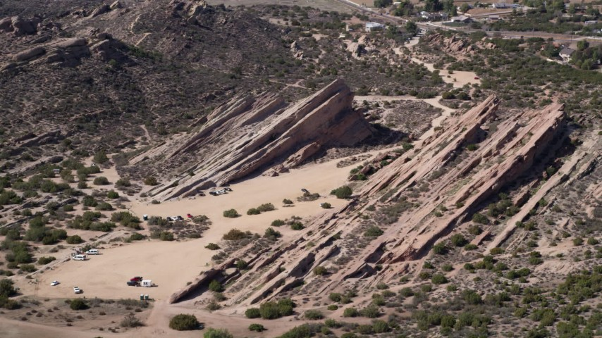 5K stock footage aerial video of rock formations in the desert at Vasquez Rocks Park, California Aerial Stock Footage | AX0005_038