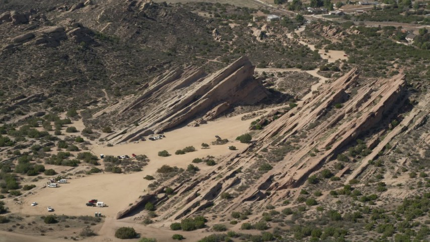 5K stock footage aerial video of rock formations in the desert at Vasquez Rocks Park, California Aerial Stock Footage | AX0005_038E