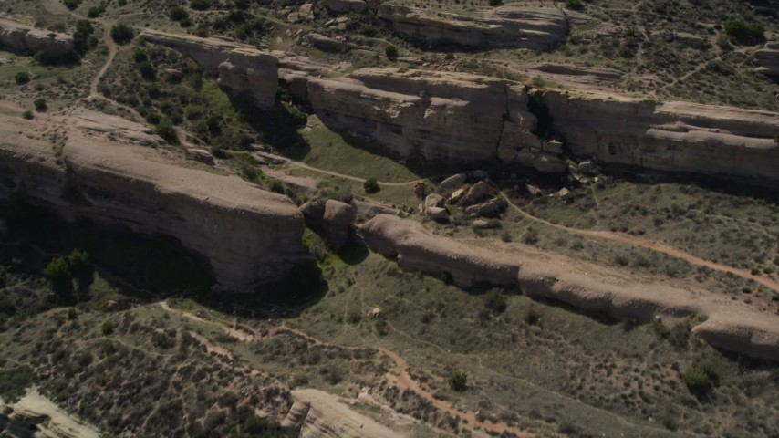 5K stock footage aerial video fly over layers of rocks at Vasquez Rocks Park in the Mojave Desert, California Aerial Stock Footage | AX0005_041E