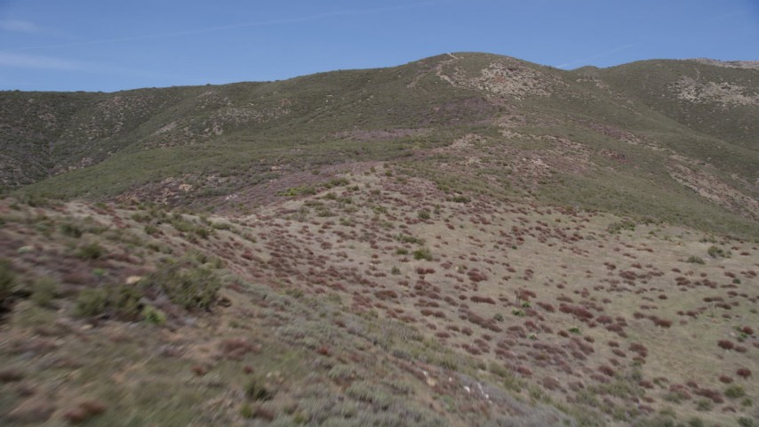 5K stock footage aerial video of flying up slopes of arid Sierra Pelona Mountains in California Aerial Stock Footage | AX0005_051
