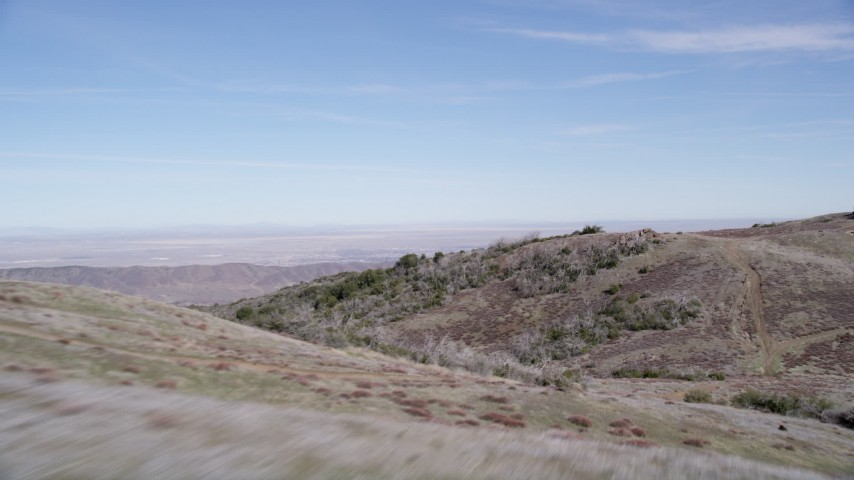 5K stock footage aerial video fly low over arid mountain ridge in the Mojave Desert, California Aerial Stock Footage | AX0005_054