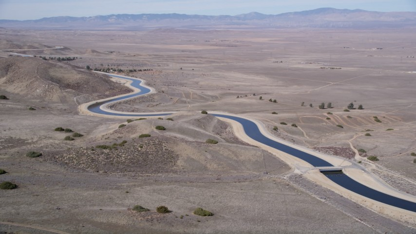 5K stock footage aerial video approach an aqueduct in the Mojave Desert of California Aerial Stock Footage | AX0005_059