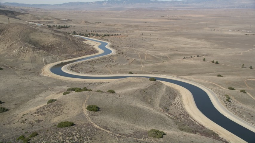 5K stock footage aerial video approach an aqueduct in the Mojave Desert of California Aerial Stock Footage | AX0005_059E
