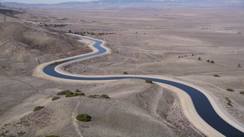 5K stock footage aerial video fly over the California Aqueduct in the desert in California Aerial Stock Footage | AX0005_060