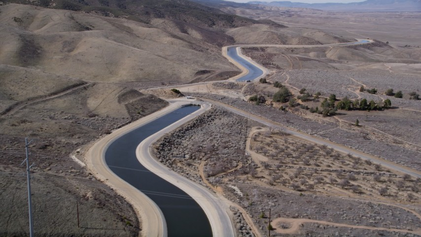 5K stock footage aerial video fly over a desert aqueduct in the Mojave Desert of California Aerial Stock Footage | AX0005_062