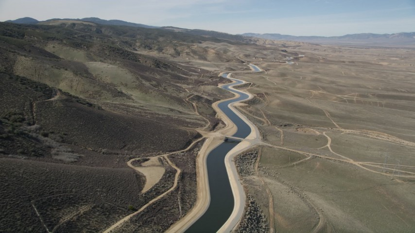 5K stock footage aerial video of California Aqueduct in the Mojave Desert of California Aerial Stock Footage | AX0005_065