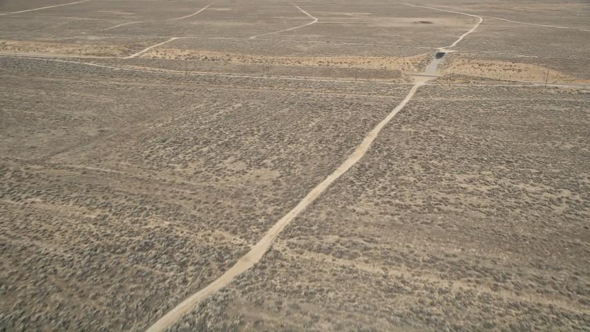 5K stock footage aerial video orbit dirt road in the desert in Antelope Valley, California Aerial Stock Footage | AX0005_066
