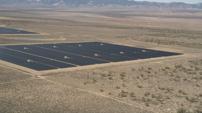 5K stock footage aerial video of a solar panel array in the desert of Antelope Valley, California Aerial Stock Footage | AX0005_076E
