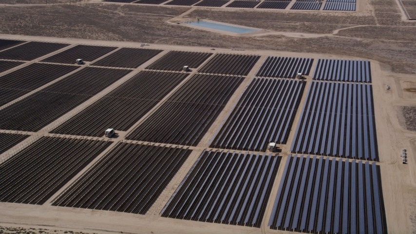 5K stock footage aerial video orbit massive Mojave Desert solar array in Antelope Valley, California Aerial Stock Footage | AX0005_077