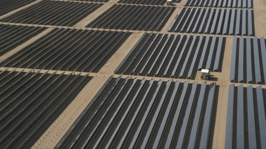 5K stock footage aerial video of an orbit of solar array panels in the desert of Antelope Valley, California Aerial Stock Footage | AX0005_079