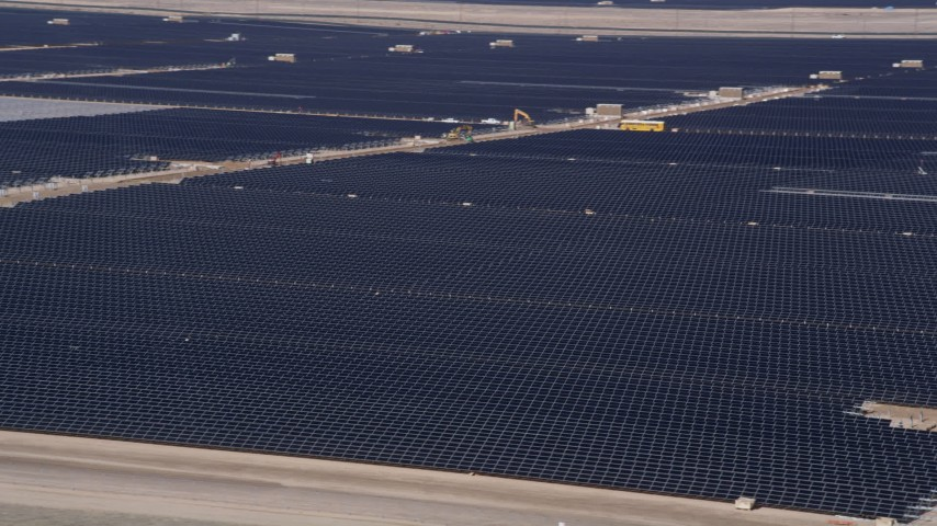 5K stock footage aerial video orbit several rows of solar panels at an array in the Mojave Desert, California Aerial Stock Footage | AX0005_085