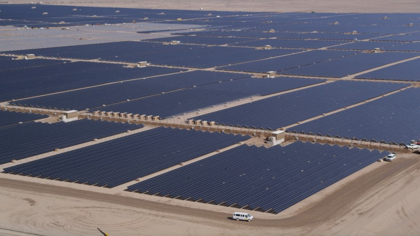 5K stock footage aerial video orbiting panels at a large solar energy farm in the Mojave Desert, California Aerial Stock Footage | AX0005_089