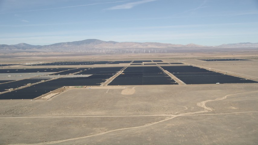 5K stock footage aerial video of a reverse view of a solar energy farm in the Mojave Desert, California Aerial Stock Footage | AX0005_094