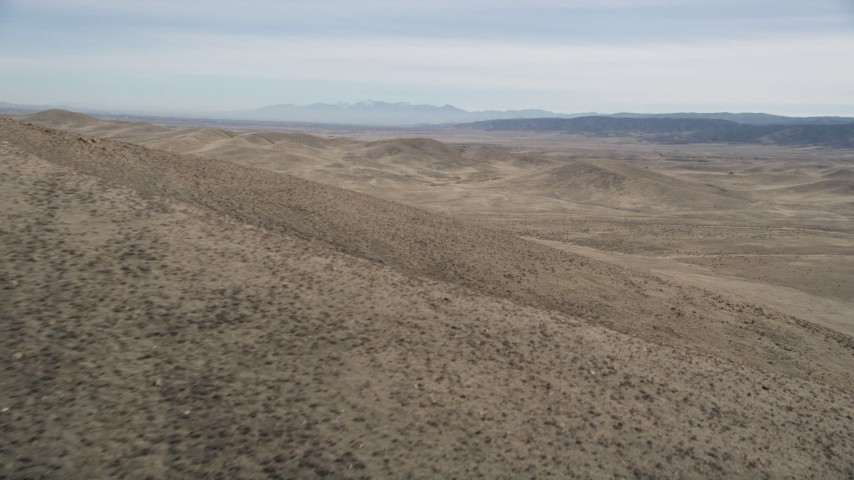 5K stock footage aerial video fly by desert mountain in Antelope Valley, California  Aerial Stock Footage | AX0005_095