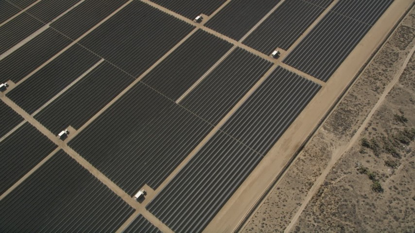 5K stock footage aerial video of bird's eye orbit of Mojave Desert solar energy array in California  Aerial Stock Footage | AX0005_108
