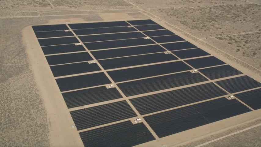 5K stock footage aerial video orbit long rows of solar panels at an energy array in the Mojave Desert, California Aerial Stock Footage | AX0005_111