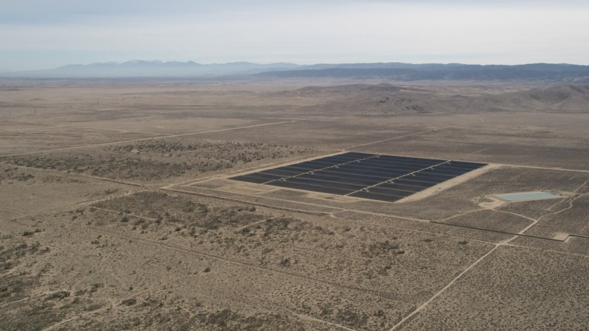 5K stock footage aerial video orbit small group of panels at a solar energy array in the Mojave Desert, California Aerial Stock Footage | AX0005_114