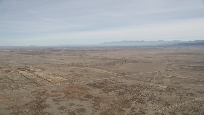 5K stock footage aerial video of flying over open desert in Antelope Valley, California Aerial Stock Footage | AX0005_116