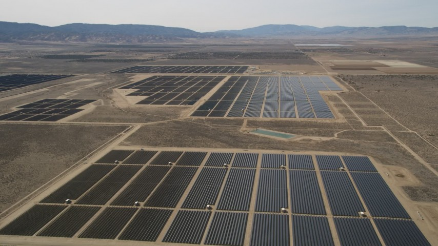 5K stock footage aerial video approach and fly over panels in a solar energy array in the Mojave Desert, California Aerial Stock Footage AX0005_118