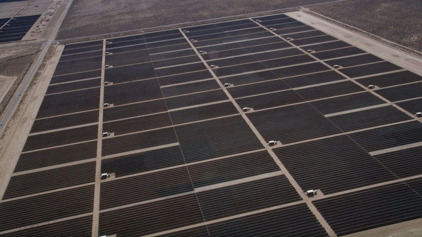 5K stock footage aerial video orbit rows of panels at a solar energy array in Antelope Valley, California Aerial Stock Footage | AX0005_122