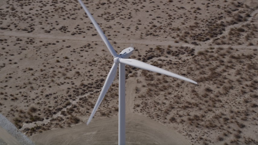 5K stock footage aerial video orbit single windmill in the Mojave Desert, California Aerial Stock Footage | AX0005_126