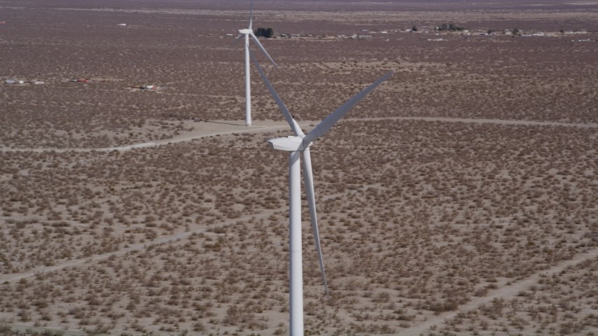 5K stock footage aerial video orbit top of a windmill in the Mojave Desert, California Aerial Stock Footage | AX0005_129