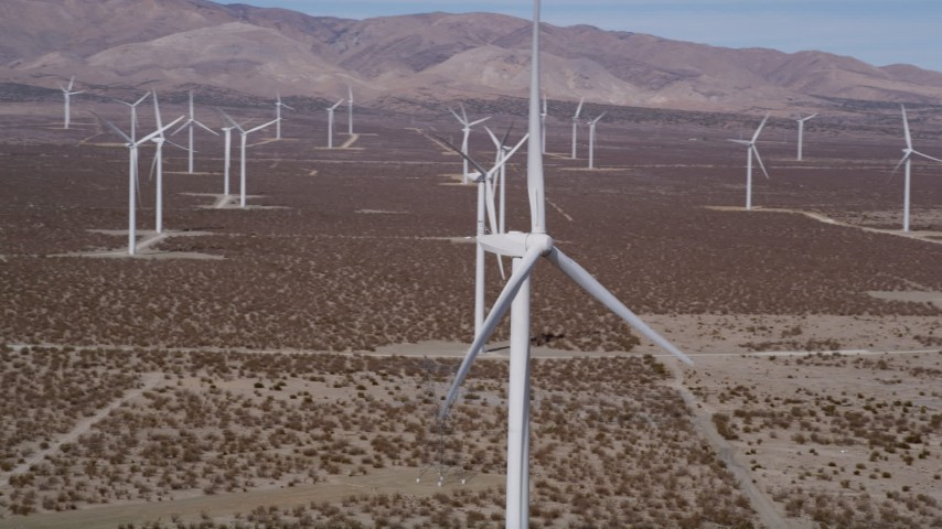 5K stock footage aerial video orbiting a windmill at a Mojave Desert Wind Farm, California Aerial Stock Footage | AX0005_130