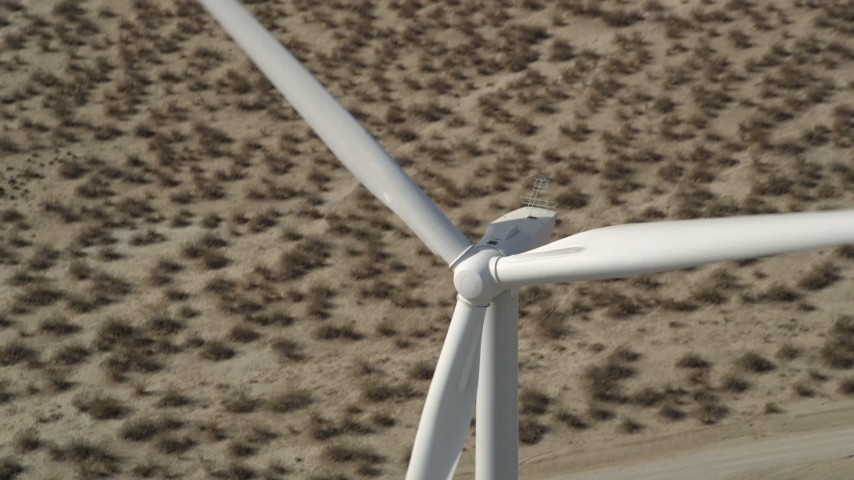 5K stock footage aerial video of flying over the top of a windmill in the California, Mojave Desert Aerial Stock Footage | AX0005_133