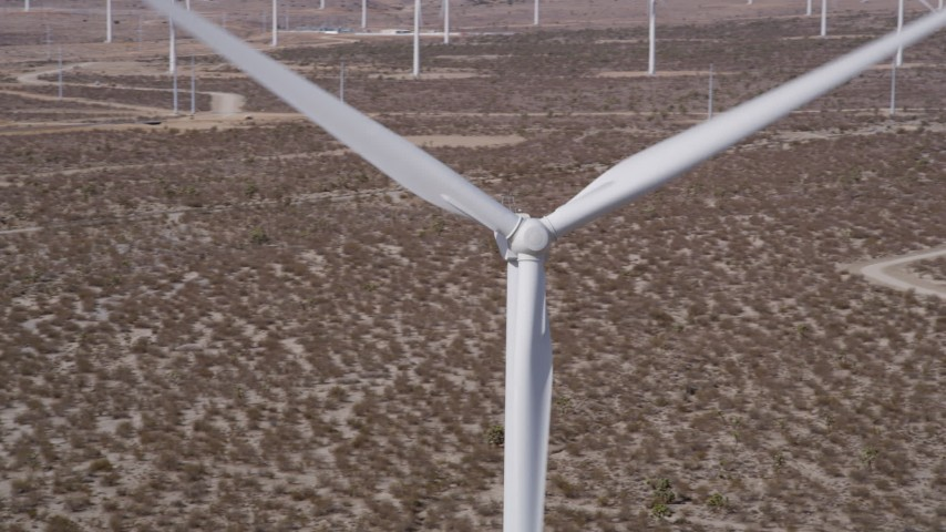 5K stock footage aerial video of orbit spinning windmill blades in Mojave Desert of California Aerial Stock Footage | AX0005_136