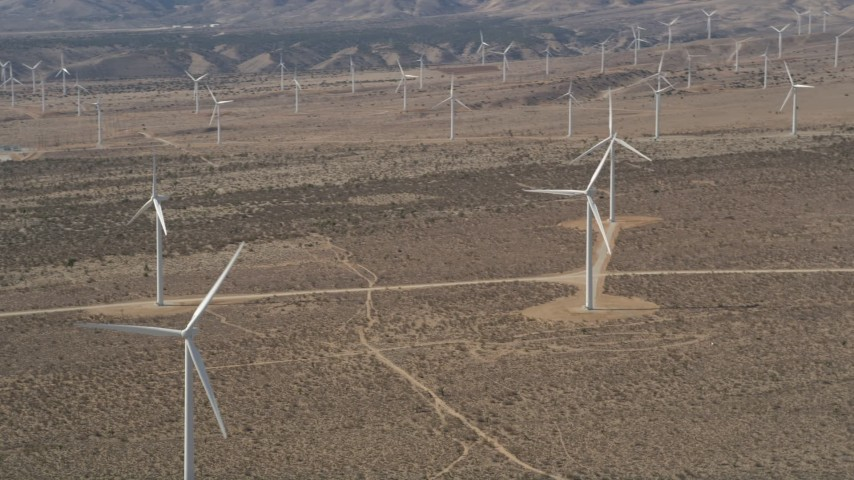5K stock footage aerial video orbiting a wind farm in the California Desert Aerial Stock Footage | AX0005_142