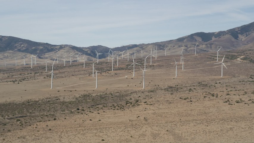 5K stock footage aerial video approach wind farm windmills in the desert of Antelope Valley, California Aerial Stock Footage   AX0005_144