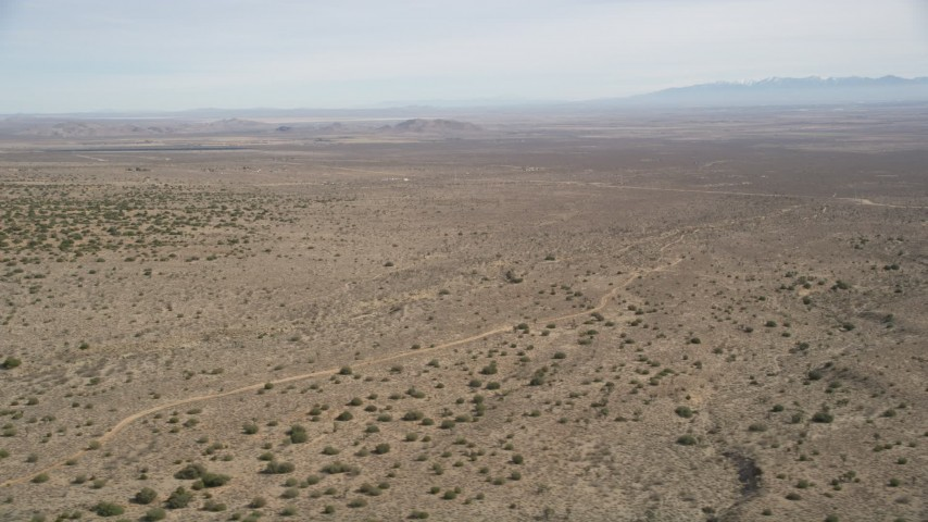 5K stock footage aerial video of passing by open desert in Antelope Valley, California Aerial Stock Footage   AX0005_146