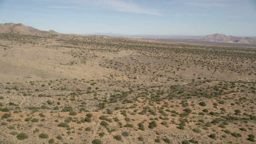 5K stock footage aerial video of flying low over open desert in Antelope Valley, California Aerial Stock Footage | AX0005_147