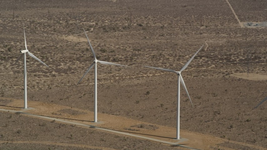 5K stock footage aerial video approach a pair of windmills at a desert wind farm in Antelope Valley, California Aerial Stock Footage | AX0006_010