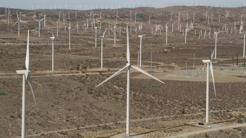 5K stock footage aerial video orbit a windmill at a desert wind farm in Antelope Valley, California Aerial Stock Footage | AX0006_014