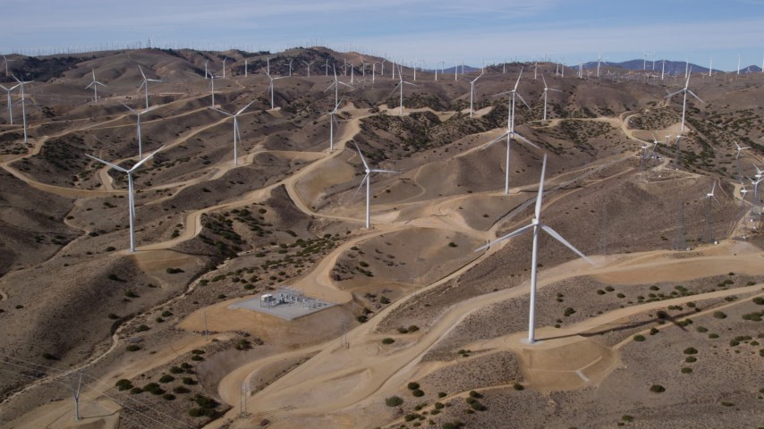 5K stock footage aerial video approach several windmills at desert wind farm in Antelope Valley, California Aerial Stock Footage | AX0006_021