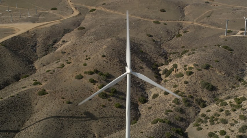 5K stock footage aerial video tilt to a bird's eye view of a single windmill at a desert wind farm in Antelope Valley, California Aerial Stock Footage | AX0006_024