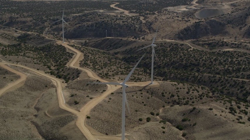 5K stock footage aerial video orbit a single windmill at a desert wind farm in the Mojave Desert, California Aerial Stock Footage | AX0006_025