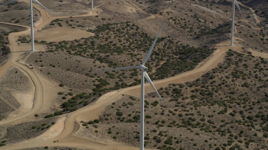 5K stock footage aerial video orbit a lone windmill at a desert wind farm in Antelope Valley, California Aerial Stock Footage | AX0006_026