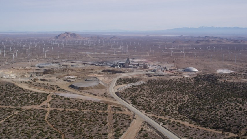 5K stock footage aerial video orbit a quarry by a field of windmills in the Mojave Desert, California Aerial Stock Footage | AX0006_030