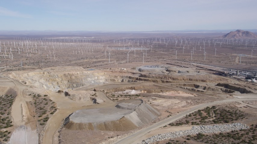 5K stock footage aerial video orbiting a desert quarry by a wind farm in Antelope Valley, California Aerial Stock Footage | AX0006_031