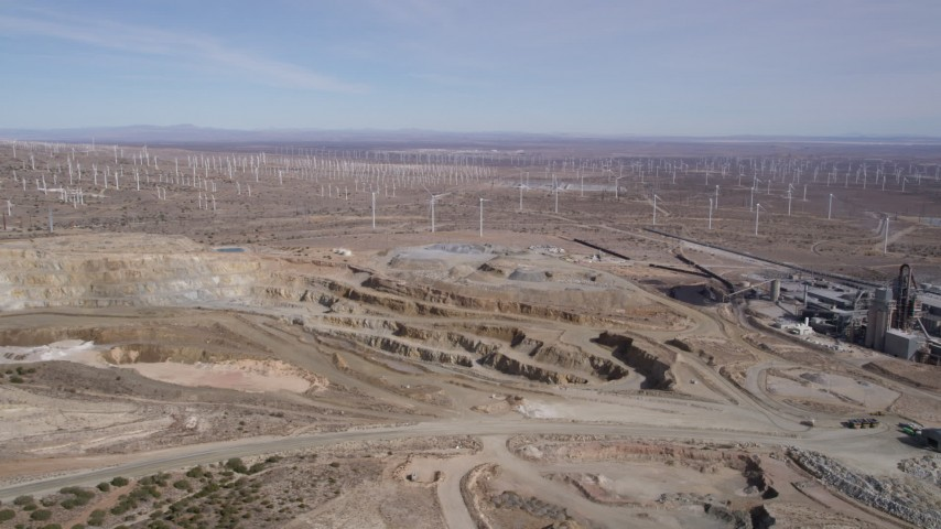 5K stock footage aerial video orbit pit of desert quarry near windmills in Antelope Valley, California Aerial Stock Footage | AX0006_032
