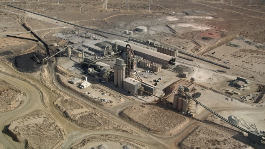 5K stock footage aerial video orbit quarry buildings in the Mojave Desert, California Aerial Stock Footage | AX0006_038