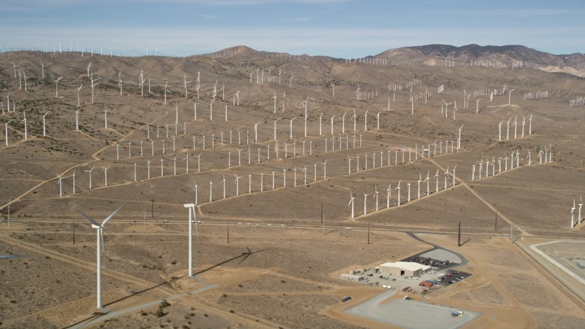 5K stock footage aerial video of rows of windmills at a wind energy farm in the Mojave Desert of California Aerial Stock Footage | AX0006_043