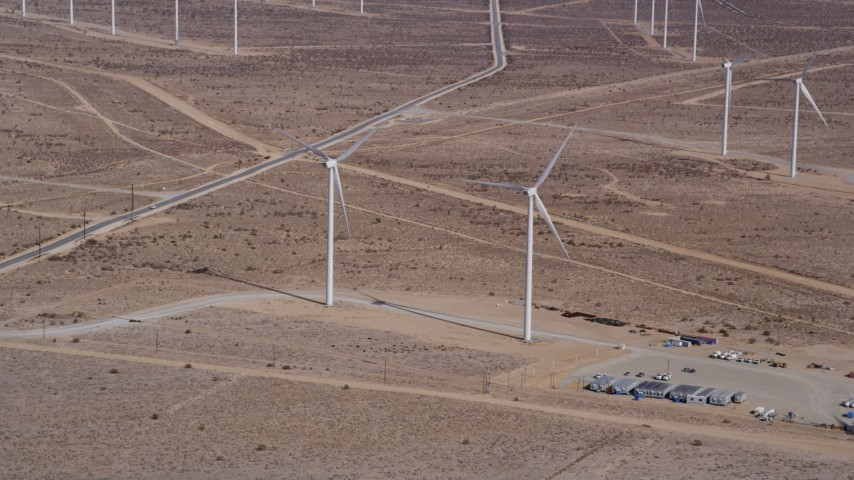 5K stock footage aerial video approach two windmills at a wind energy farm in the California desert Aerial Stock Footage | AX0006_045